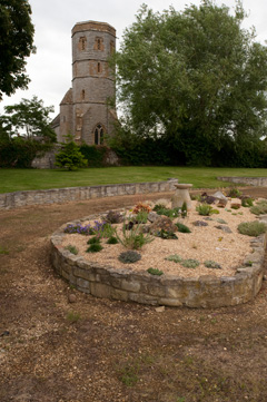 The garden looks out to Podimore Church