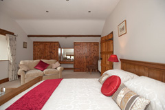 The large attractive Orchard bedroom at Church Farm Barn B & B